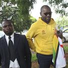 Pastor and activist Evan Mawarire, centre, is appearing at court (AP)