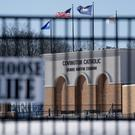 Flags fly over the Covington Catholic High School stadium in Park Kills, Kentucky (Bryan Woolston/AP)