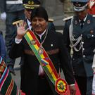 Bolivia's President Evo Morales waves as he arrives at Congress (Juan Karita/AP)