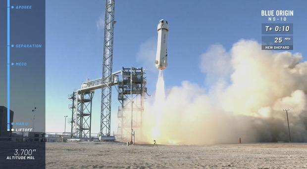 The New Shepard capsule and booster lifts off from Blue Origin's site in west Texas (Blue Origin via AP)