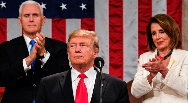 US President Donald Trump delivers the State of the Union address alongside Vice President Mike Pence and Speaker of the House Nancy Pelosi