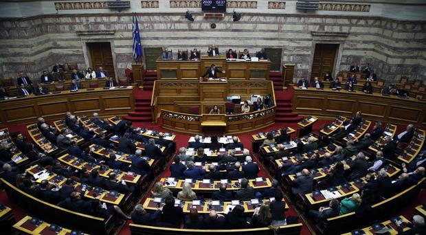Greece's prime minister Alexis Tsipras delivers a speech during a parliament session (Thanassis Stavrakis/AP)