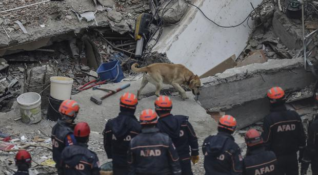 Rescue workers are continuing to work at the scene (Emrah Gurel/AP)