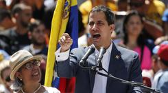 Juan Guaido speaks to supporters during a demonstration against the government of president Nicolas Maduro, in Caracas (Ariana Cubillos/AP)