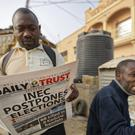 Mahmood Yakubu, chairman of the Independent National Electoral Commission, speaks about the election delay (AP)