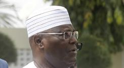 Nigerian presidential candidate Atiku Abubakar, of the People's Democratic Party, speaks to journalists after the presidential election was delayed by the Independent National Electoral Commission (Sunday Alamba/AP)