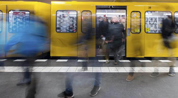 Travellers leave a BVG subway train in Berlin (Lukas Schulze/dpa via AP)