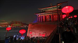 Visitors tour the Forbidden City decorated with red lanterns and illuminated with lights during the Lantern Festival in Beijing (Andy Wong/AP)