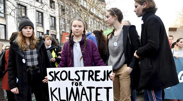 Swedish climate activist Greta Thunberg, centre, during a climate march in Brussels (Geert Vanden Wijngaert/AP)