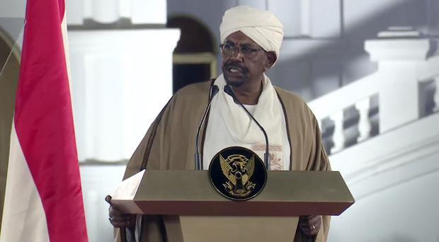 Sudan's President Omar al-Bashir speaks at the Presidential Palace (Mohamed Abuamrain/AP)