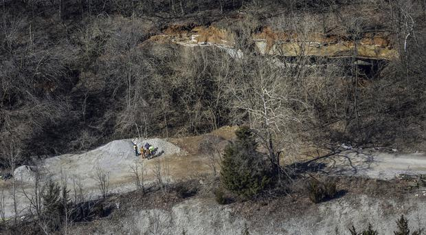 The edge of a giant sinkhole at Louisville Zoo (Jeff Faughender/Courier Journal via AP)