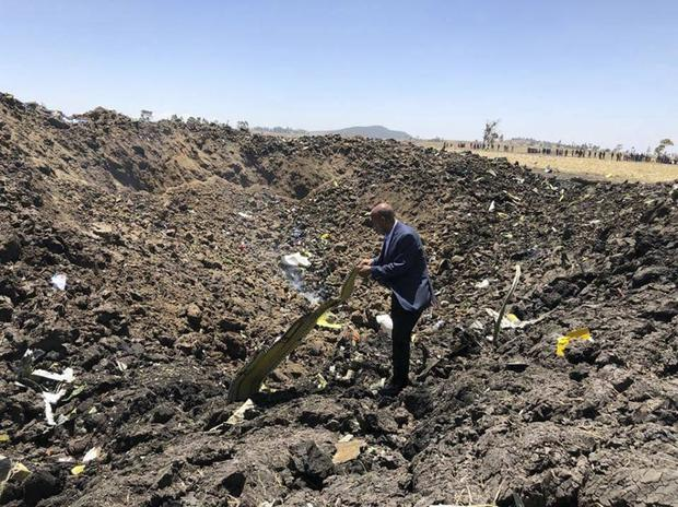 The CEO of Ethiopian Airlines looks at the wreckage of the plane (Facebook via AP)