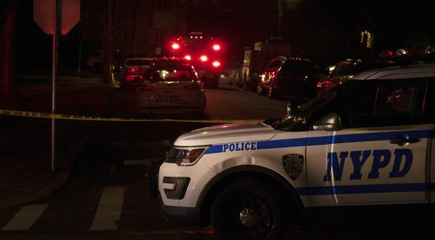 Police and fire crews responding to a report of shots fired in New York (Joseph Ostapiuk/Staten Island Advance via AP)