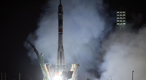 The Soyuz-FG rocket booster with Soyuz MS-12 space ship blasts off (Dmitri Lovetsky/AP)