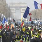 Yellow vest demonstrators invade the Champs-Elysees (Christophe Ena/PA)
