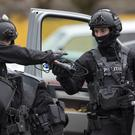 Dutch counter-terrorism police prepare to enter a house after the shooting incident (Peter Dejong/AP/PA)
