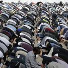 Muslims pray during Friday prayers at Hagley Park in Christchurch (Mark Baker/AP)