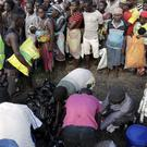 People queue to receive food in Nhamatanda, about 60 miles west of Beira, Mozambique (AP)