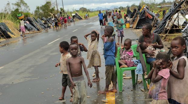 Survivors of Cyclone Idai in a makeshift shelter by the roadside near Nhamatanda (Tsvangirayi Mukwazhi/AP)