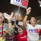 Pheu Thai supporters cheer election results at party headquarters in Bangkok (AP)