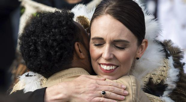 Jacinda Ardern embraces a member of the Muslim community following the national remembrance service for the victims of the March 15 mosques attack (New Zealand government/Mark Tantrum/AP)