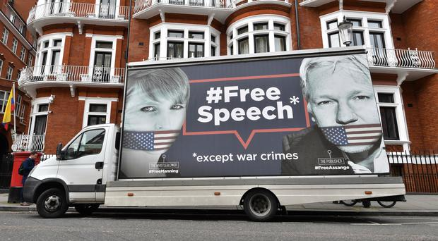 A billboard van outside the Ecuadorian Embassy in London (John Stillwell/PA)