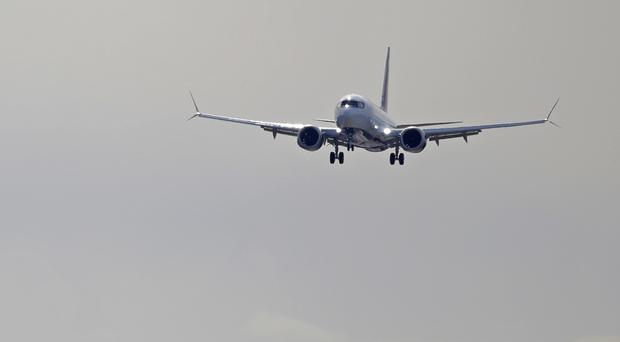 The company said that starting in mid-April it will cut production of the 737 Max from 52 to 42 planes per month (Ted S Warren/AP)