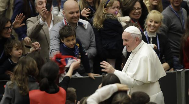 Pope Francis leaves after an audience with students and teachers of the San Carlo Institute of Milan (Alessandra Tarantino/AP)