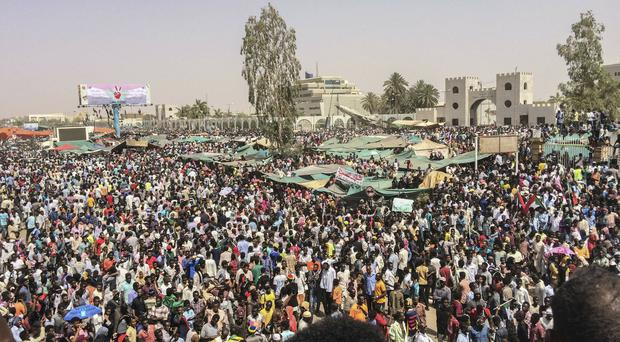 Sudanese celebrate after the military forced president Omar al-Bashir to step down (AP)
