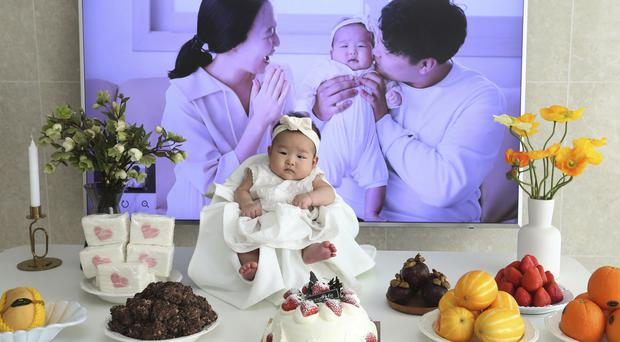 Lee Dong Kil's daughter Lee Yoon Seol celebrates the 100th day of her birth in Daejeon, South Korea (Ahn Young-joon/AP)
