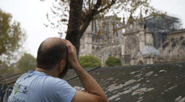 Monuments have a particularly profound effect on people in France (AP Photo/Christophe Ena)
