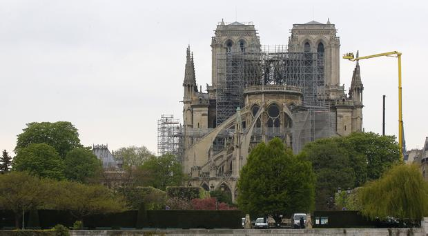 Firefighters acted quickly to save the cathedral from burning to the ground (AP Photo/Michel Euler)