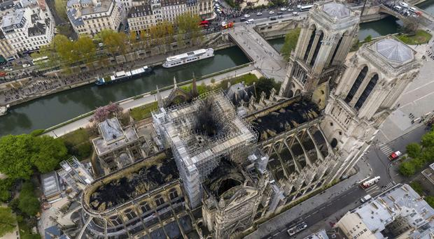 An aerial shot of the fire damage to Notre Dame Cathedral in Paris (Gigarama.ru via AP)