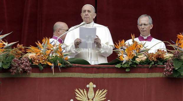 Pope Francis delivers his Urbi et Orbi message in St Peter's Square (Andrew Medichini/AP)
