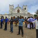 Soldiers secure the area around St Anthony's Shrine (Rohan Karunarathne/AP)
