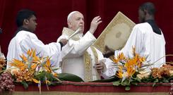 """Pope Francis delivers his Urbi Et Orbi (""""to the city and the world"""") blessing on Easter Sunday (Andrew Medichini/AP)"""