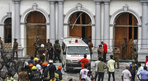 Sri Lankan army soldiers secure the area around St Anthony Shrine (Chamila Karunathne/AP)