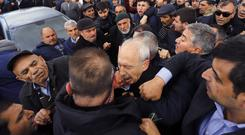 A man punches Kemal Kilicdaroglu, the leader of Turkey's main opposition Republican People's Party (AP)