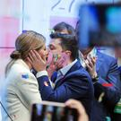 Volodymyr Zelenskiy and his wife Olena Zelenska celebrate (Vadim Ghirda/AP)
