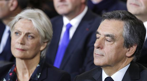 Francois Fillon and his wife Penelope (Christophe Ena/AP)