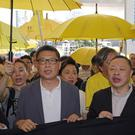 Occupy Central leaders, from left, Lee Wing-tat, Chan Kin-man, Benny Tai and Chu Yiu-ming enter a court in Hong Kong (Kin Cheung/AP)