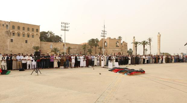 Mourners gather for funeral prayers for fighters killed by warplanes of Field Marshal Khalifa Hifter's forces (HAzem Ahmed/AP)