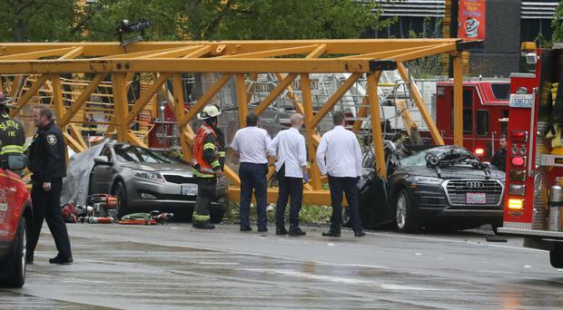 Emergency crews work at the scene of a construction crane collapse in Seattle (Alan Berner/The Seattle Times via AP)