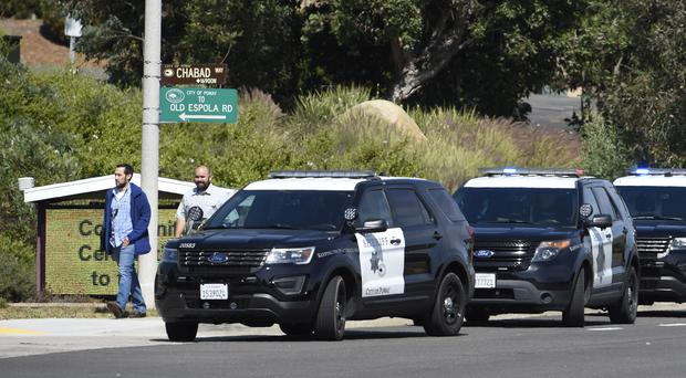 San Diego County Sheriff's vehicles line up outside of the Chabad of Poway Synagogue (Denis Poroy/AP)