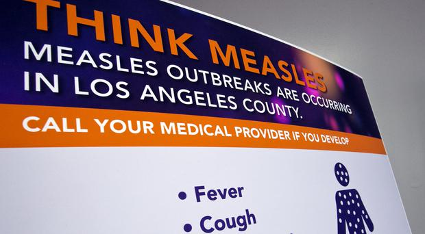 A poster released by Los Angeles County Department of Public Health (Damian Dovarganes/AP)