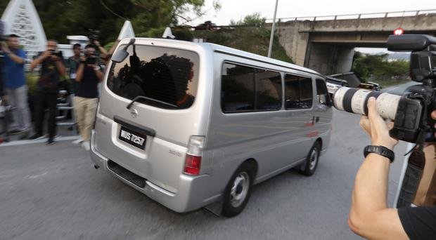 A car, which is believed to be carrying Vietnamese Doan Thi Huong, leaves a prison in Kajang, Malaysia (VIncent Thian/AP)