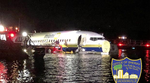 Authorities work at the scene of a plane in the water in Jacksonville, Florida (Jacksonville Sheriff's Office via AP}