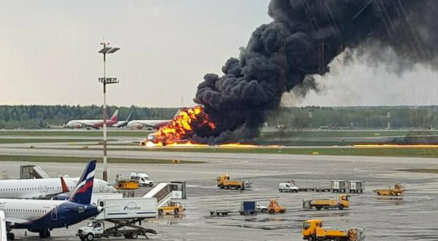 Smoke rises from a fire on a plane at Moscow's Sheremetyevo airport (Riccardo Dalla Francesca via AP)