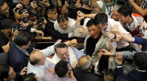 A scuffle in the chamber at Legislative Council in Hong Kong (Kin Cheung/AP)