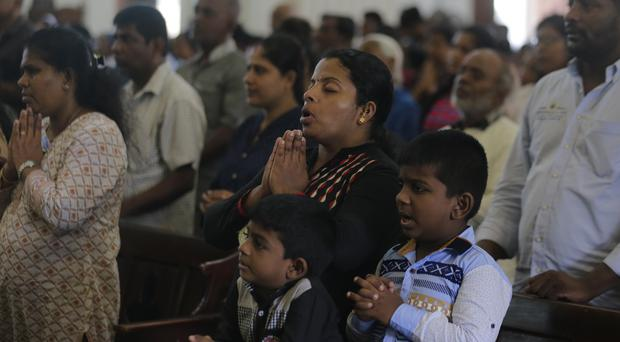Prayers are said during a holy mass held to bless victims of the Easter Sunday attacks in Colombo, Sri Lanka (Eranga Jayawardena/AP)